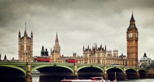 London. Big Ben, River Thames, red buses and boat vintage