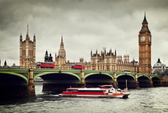 London. Big Ben, River Thames, red buses and boat vintage